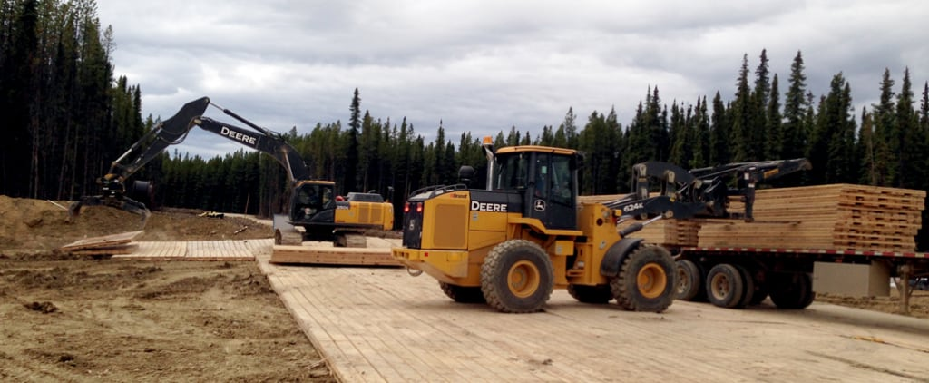 Little Guy Rentals trucking and installation services preparing a temporary roadway in Northern Alberta
